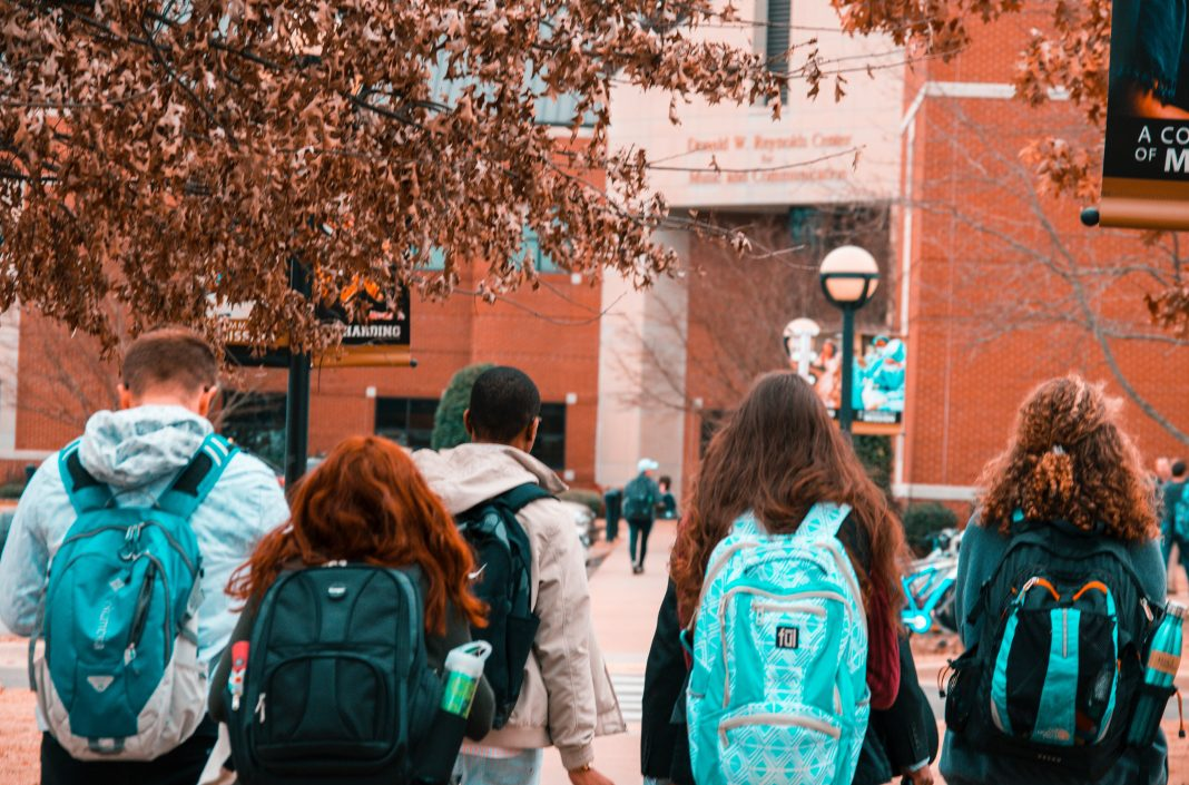students walking into a building